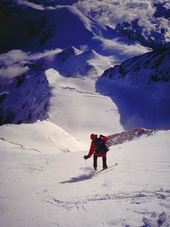 Doug Byerly skiing the Orient Express on Denali (Mt. McKinley) around 10:30 at night. 1995