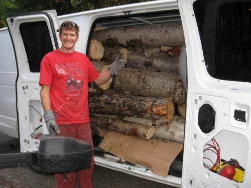 "Got wood?  Ski partner Brad ""B-Rad"" Barlage shows off his van stuffed with wood."